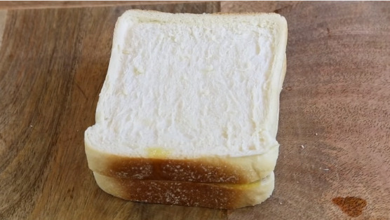 Place 2nd slice of bread on top