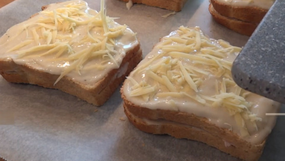 Sprinkle each sandwich with the grated Gruyere Cheese