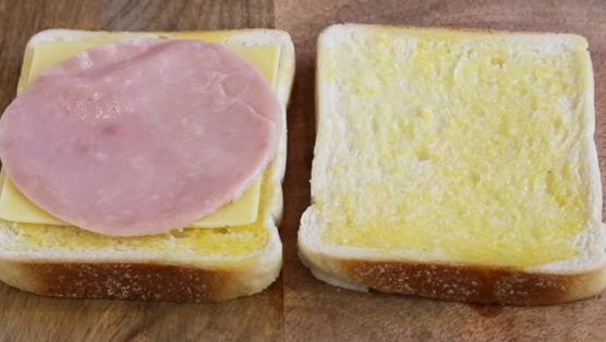 Top bread with ham and cheese