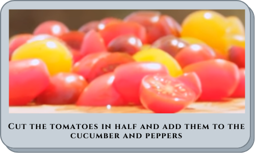 Cut the tomatoes in half and add them to the cucumber and peppers