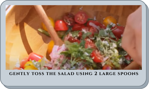 gently toss the salad using 2 large spoons